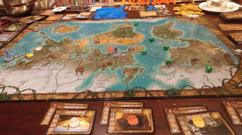 An image of some of the pieces in Fortune and Glory played at the Mancala Monk board game cafe