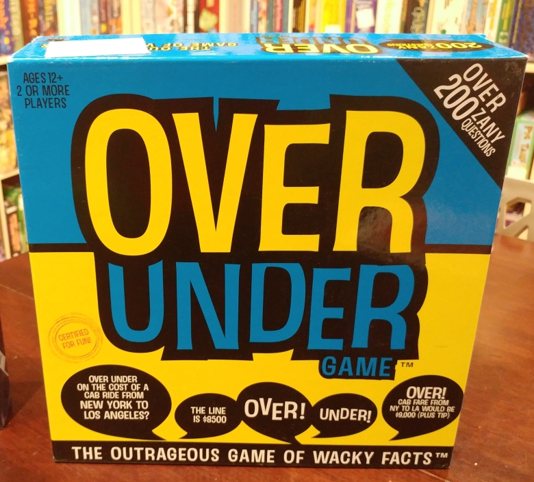 Picture of the box of Over Under played at the Mancala Monk board game cafe