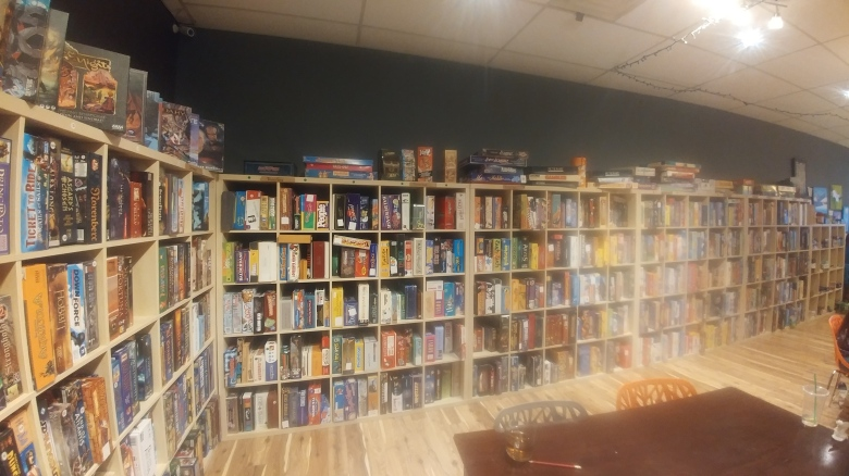 The wall of games at the Mancala Monk board game cafe in Hamilton, Ontario